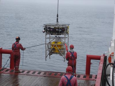 A robot carrying seismic recorder is launched towards the seabed