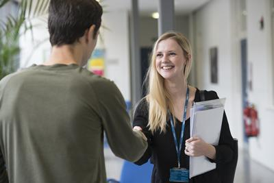 student and tutor shaking hands