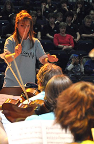 Southampton University Symphony Orchestra plays to children at Cantell School.