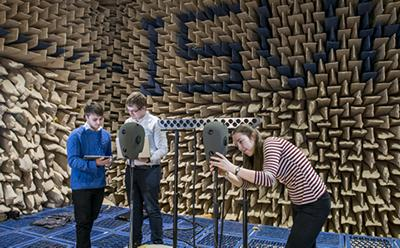 Students testing their loudspeaker project in the anechoic chamber