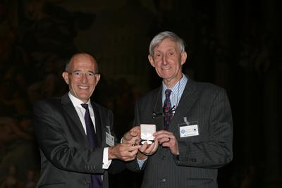 Ian is being presented with the 'medal and honorary membership of RSPSoc for life' from the President of the RSPSoc – Professor Paul Curran