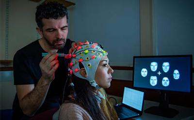 EEG hat with probes- two people using it