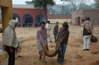 Carrying sand for water tank foundations