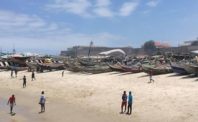 People on beach in Ghana.
