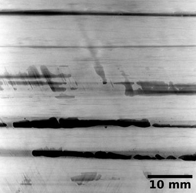 Porosity in a carbon fibre-reinforced composite: sum projection through 0.9 mm thickness
