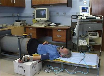 Dr. David Simpson in the experimental system to measure the control of blood flow to the brain