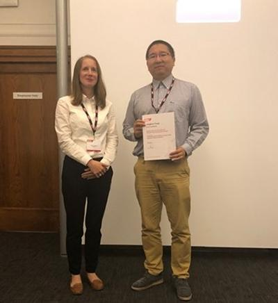 Dr Jinghua Tang accepting award