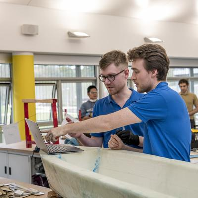 Fourth-year students working on their autonomous vessel project