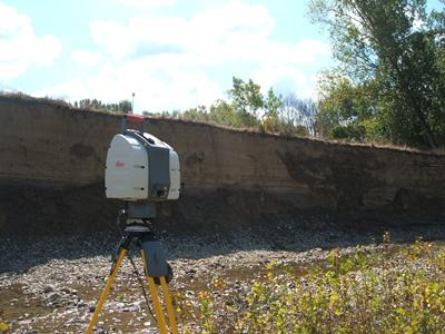 View of the deeply incised (~4m) river bank of the Cecina River, central Italy, showing the TLS