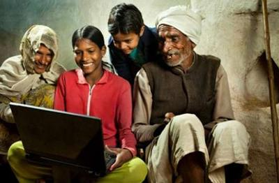 Smiling Indians looking at laptop