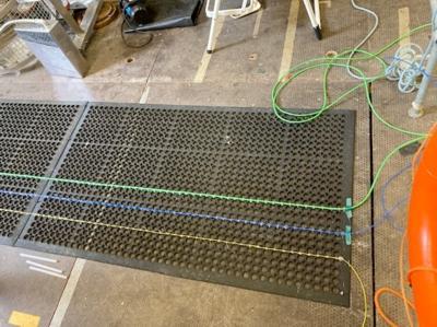 Optical Fibres Laid on a Rubber Mat