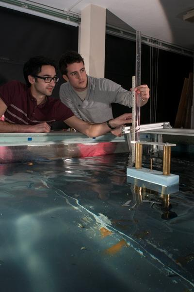 Students conducting model tests of a buoyancy type wave energy converter