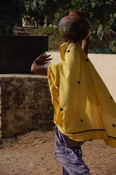 Abheypur resident carrying water back to her home