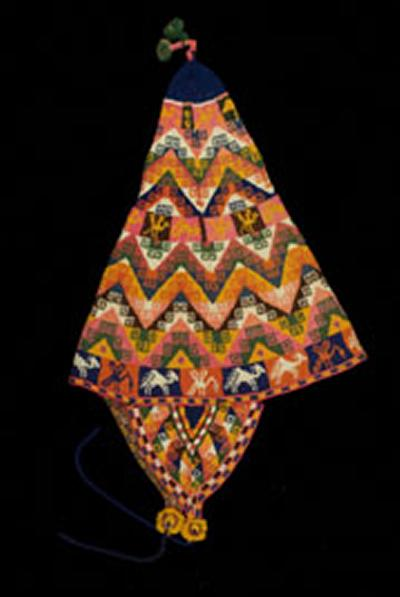 This cap originates from Bolivia in the mid to late 1900s, part of the Knitting Reference Library.