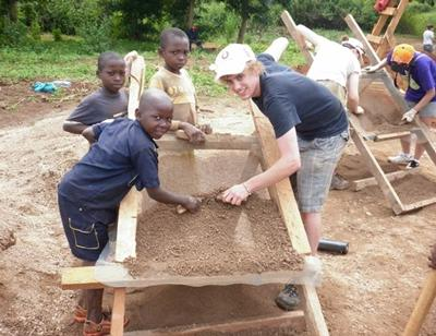 The students visit the village to help with the final stages of the build