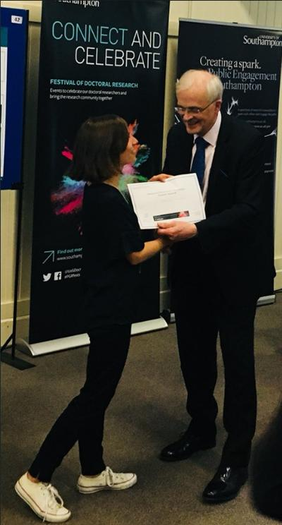 Catarina Moura presented with her award by Sir Christopher Snowden