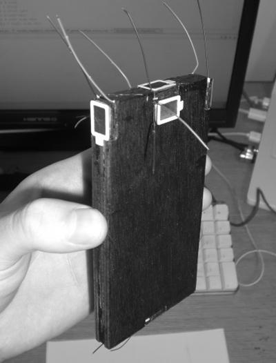 Mobile phone mock-up with embedded loudspeakers.