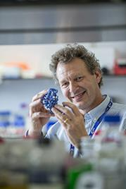 Professor Tim Elliott in a lab