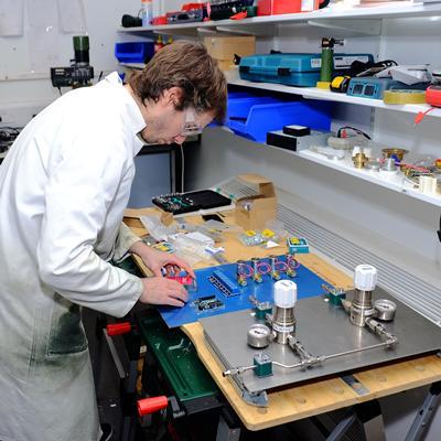 Researcher building NMR hardware