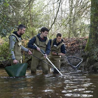 Students doing electric fishing training in the New Forest