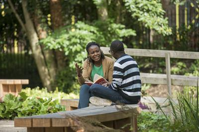 Students sitting in garden
