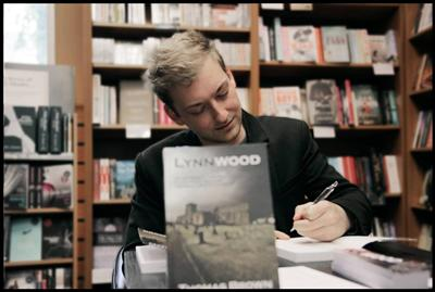 Thomas Brown with his book Lynnwood