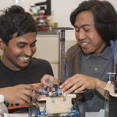 Students building robots for the Eurobot competition