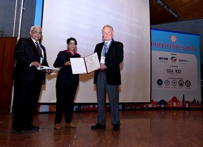 3 people receiving an award