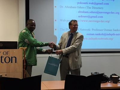 Professor Leighton presenting a gift to George Wak