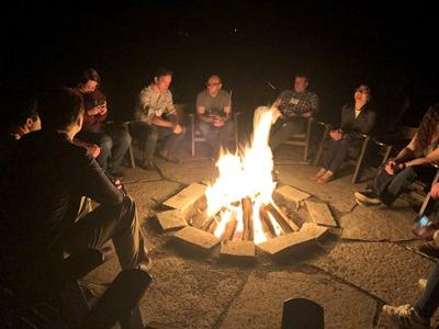 Students round campfire