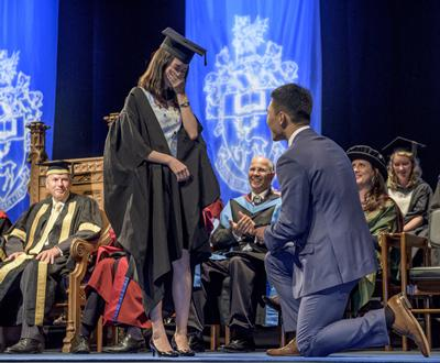 Shiyi Ying popped the question to Yu-Yen Ou during a Business, Law and Art graduation ceremony.