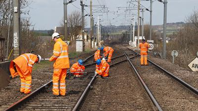 Workers on rail network