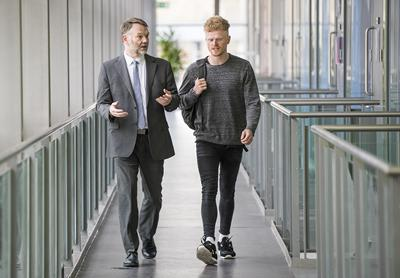 Student and tutor walking and talking