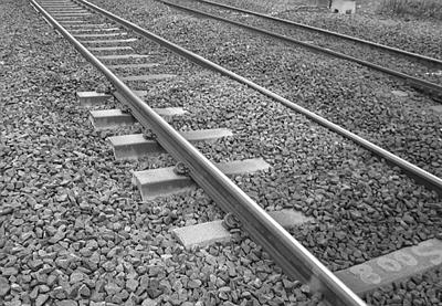 An example of a ballast migration zone.  The ballast has heaped against the low rail on canted track on a sharp curve