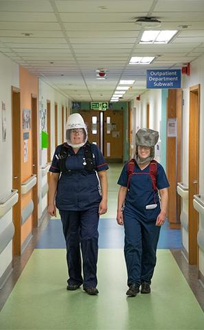NHS staff walking through the hospital wearing PeRSos, image by Ric Gillams