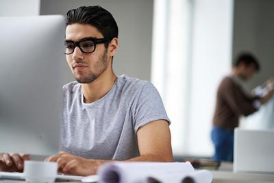 A student writing their CV