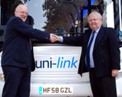 Simon Higman, University Registrar and Chief Operating Officer (left) and George Fair with one of the new uni-link buses