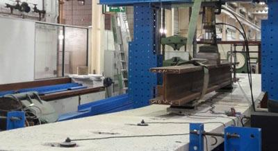 Full-scale (10 m) demountable steel-concrete composite bridge beam test