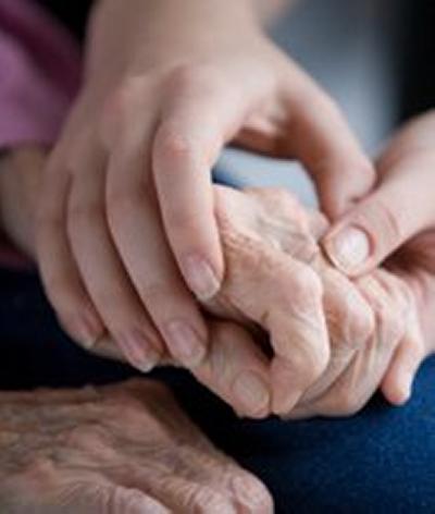 Nurse attending to elderly patient