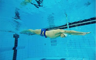A swimmer diving into the pool