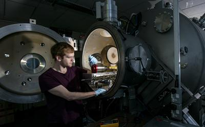 Testing a satellite in a thermal vacuum chamber