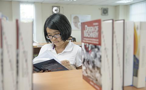 A student reading in a library.