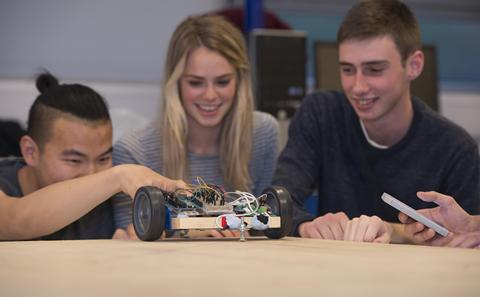 Students building a toy car