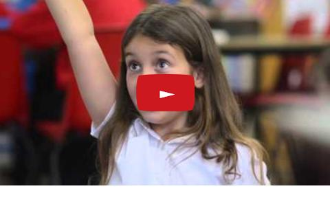 School girl putting her hand up
