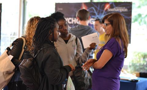 Students talking to representative