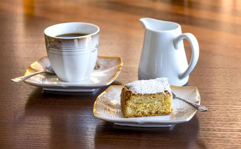 Cup of tea and cake on a table