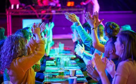 Students dancing in a nightclub.