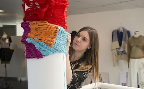 Student working with textiles