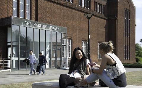Students talking outside library
