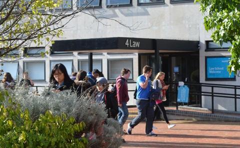 students walking outside Law